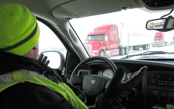 Reporter photo by Rod Rose<br /> Lebanon Police Lt. Brent Wheat gestures at a line of trucks trying to reach a truck stop Monday afternoon.