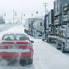Reporter photo by Rod Rose<br /> The driver of a car driving by a line of parked semi trucks llooks for the entrance to the Flying J Truck Stop on South Lebanon Street Monday afternoon. So many drivers were sheltering at the truck stop that the overflow strtetched across the I-65 overpass.