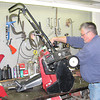 "Reporter photo by Rod Rose<br /> Dean Quick works on an electric snowblower at Howard's Lawn & Garden, 1115 W. South St., Lebanon. Quick said that 90 percent of all repairs on gas-powered snow blowers involve a fuel issue. ""People will leave old gas in them,"" he said. As of Thursday afternoon, Quick said, the shop was up to date on repairs. ""We're staying right with them, at the moment."" The unit he is working on is a Toro electric model."