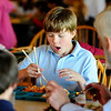 JAPAN<br /> Tommy Simmons, a fourth-grader at Alexander Dawson School, struggles to use chopsticks during Japan Day at the school. The event was organized to raise awareness as well as relief for victims of Japan's earthquake.<br /> Photo by Marty Caivano/April 28, 2011