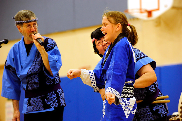 "JAPAN<br /> Hope Kotsaftis, right, fifth-grader at Alexander Dawson School, reacts as her Japanese-style belt is pulled tight by Toni Yagami, center, during Japan Day at the school. At left is Lance Acker, Yagami's husband. The two comprise the performance group ""Taiko with Toni and Lance."" The event was organized to raise awareness as well as relief for victims of Japan's earthquake. For a video of the event, see  <a href=""http://www.dailycamera.com"">http://www.dailycamera.com</a>.<br /> Photo by Marty Caivano/April 28, 2011"