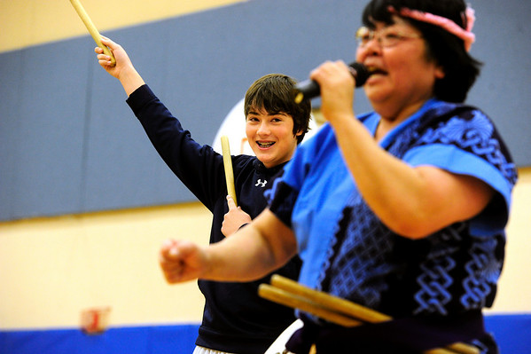 JAPAN<br /> Will Byers, left, an eighth-grader at Alexander Dawson School, prepares to play a Taiko drum under the guidance of Toni Yagami during Japan Day at the school. The event was organized to raise awareness as well as relief for victims of Japan's earthquake.<br /> Photo by Marty Caivano/April 28, 2011