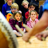 JAPAN<br /> Kindergarten students Maylei Leaneagh, left, and Skye Franklund listen to Taiko drumming during Japan Day at the school. The event was organized to raise awareness as well as relief for victims of Japan's earthquake.<br /> Photo by Marty Caivano/April 28, 2011