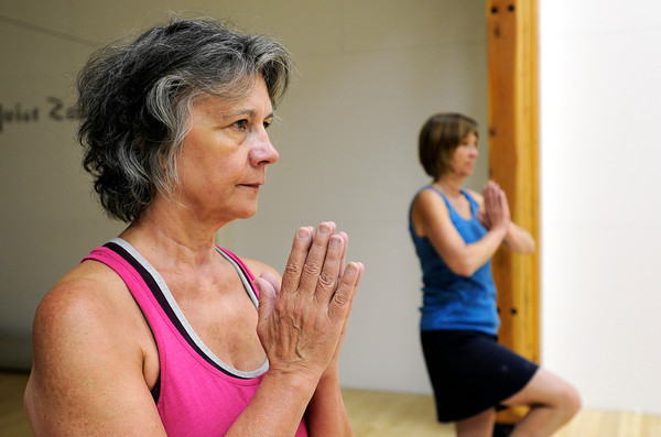"""Bambi Harrison, left, and Bambi Harrison use a yoga pose while working out during a Jazzy Zumba class on Tuesday, March 27, at the Flatirons Athletic Club in Boulder. For more photos and video of the class go to  <a href=""""http://www.dailycamera.com"""">http://www.dailycamera.com</a><br /> Jeremy Papasso/ Camera"""