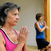 "Bambi Harrison, left, and Bambi Harrison use a yoga pose while working out during a Jazzy Zumba class on Tuesday, March 27, at the Flatirons Athletic Club in Boulder. For more photos and video of the class go to  <a href=""http://www.dailycamera.com"">http://www.dailycamera.com</a><br /> Jeremy Papasso/ Camera"