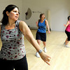 "Jackie Wong, left, dances with the rest of the class during a Jazzy Zumba workout class on Tuesday, March 27, at the Flatirons Athletic Club in Boulder. For more photos and video of the class go to  <a href=""http://www.dailycamera.com"">http://www.dailycamera.com</a><br /> Jeremy Papasso/ Camera"