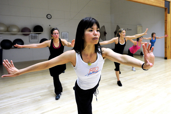"Akiko Tamura, front, works on strengthening her core muscles with the rest of the class during a Jazzy Zumba workout on Tuesday, March 27, at the Flatirons Athletic Club in Boulder. For more photos and video of the class go to  <a href=""http://www.dailycamera.com"">http://www.dailycamera.com</a><br /> Jeremy Papasso/ Camera"