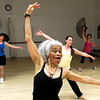 "Instructor Victoria Robertson, front, leads her class during a Jazzy Zumba workout on Tuesday, March 27, at the Flatirons Athletic Club in Boulder. For more photos and video of the class go to  <a href=""http://www.dailycamera.com"">http://www.dailycamera.com</a><br /> Jeremy Papasso/ Camera"