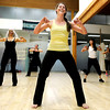 "Jamie Ryan-Karels, center, instructor Victoria Robertson, left, and Akiko Tamura, right, work on their dance moves during a Jazzy Zumba workout class on Tuesday, March 27, at the Flatirons Athletic Club in Boulder. For more photos and video of the class go to  <a href=""http://www.dailycamera.com"">http://www.dailycamera.com</a><br /> Jeremy Papasso/ Camera"