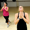 "Nancy Auge, right, and Nan Kenney use a yoga pose to cool down during a Jazzy Zumba workout class on Tuesday, March 27, at the Flatirons Athletic Club in Boulder. For more photos and video of the class go to  <a href=""http://www.dailycamera.com"">http://www.dailycamera.com</a><br /> Jeremy Papasso/ Camera"
