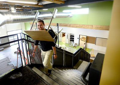 0204JA1.jpg Mark Cuthbortson, 7th grade social studies teacher, laughs has he carries a new desk up the stairs to at classroom while getting Jefferson Academy Charter School's new building ready for classes in Broomfield, Colorado February 4, 2013.  DAILY CAMERA/ MARK LEFFINGWELL