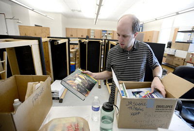 0204JA3.jpg Nathan Kirkkley, science teacher, unpacks books while getting Jefferson Academy Charter School's new building ready for classes in Broomfield, Colorado February 4, 2013.  DAILY CAMERA/ MARK LEFFINGWELL