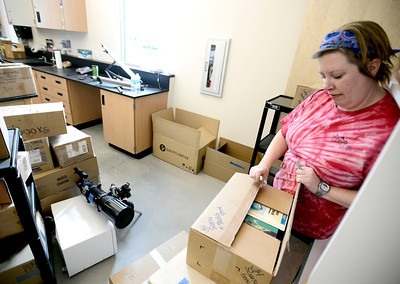 0204JA4.jpg Ember Babcock, science teacher, unpacks books while getting Jefferson Academy Charter School's new building ready for classes in Broomfield, Colorado February 4, 2013.  DAILY CAMERA/ MARK LEFFINGWELL