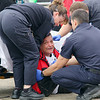 Sandrino Oliver, over taken by grief, is helped by EMT's just before being taken way by ambulance after arriving at the vigil for his nephew Jeremiah Oliver on Kimball Street in Fitchburg. They believe that they may have found his body today on I-190 in Sterling. SENTINEL & ENTERPRISE/JOHN LOVE