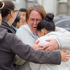 Helen Valcourt hugs her granddaughter Natalee Oliver, 18, at the vigil for Jeremiah Oliver on Kimball Street in Fitchburg. They believe that they may have found his body today on I-190 in Sterling. SENTINEL & ENTERPRISE/JOHN LOVE