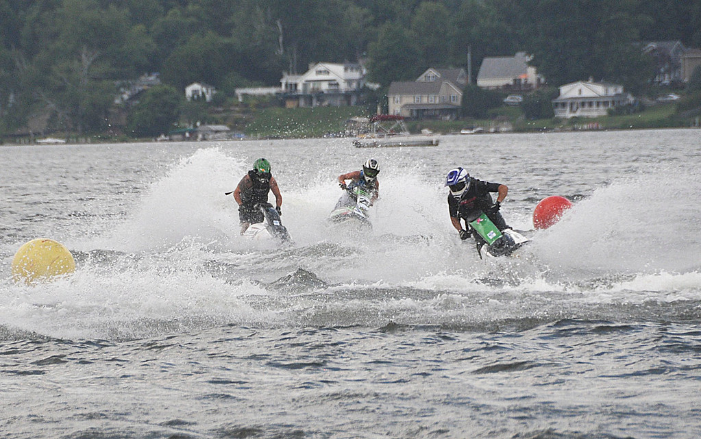 . Racers run their Jet Skis on Pontoosuc Lake during sanctioned races on Saturday, July 12, 2914 (Scott Stafford/Berkshire Eagle Staff)