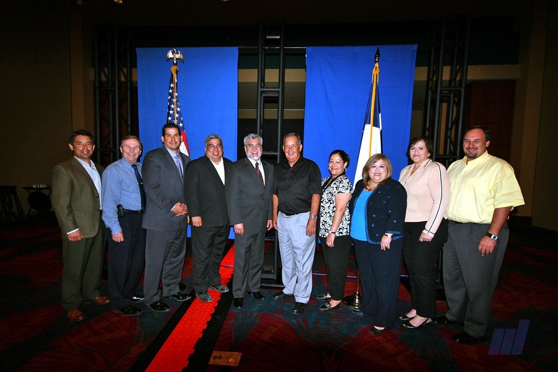 McAllen and Edinburg City Commission and State Representative Aaron Pena pose for photo.