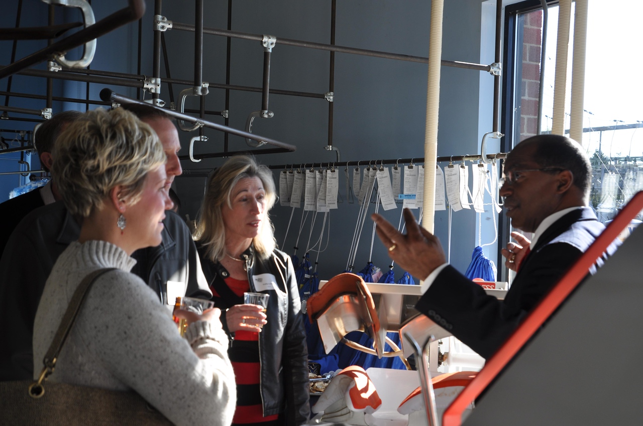ASHLEY FOX / GAZETTE  Delmar Jones gives a tour to guests at Jonesy's Classic Cleaners on Tuesday evening.