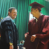 Globe/Roger Nomer<br /> Joplin Superintendent CJ Huff congratulates Sergio Lund after receiving his diploma at graduation on Sunday.