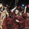 Globe/Roger Nomer<br /> (from left) Joplin High graduates Karlie Besendorfer, Maja Birch and Kylie Bird celebrate their graduation at the end of Sunday's ceremony.