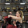 Globe/Roger Nomer<br /> Julia Tucker helps Joplin High senior Alicia Pierson tie on her tassel at the Leggett and Platt Athletic Center on Sunday afternoon.