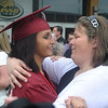 Globe/Roger Nomer<br /> Tahnee Edgerton, left, congratulates her sisiter Akeecia Jason following Sunday's graduation.