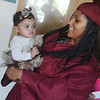 Globe/Roger Nomer<br /> Brittany Copeland plays with her daughter Zakiya Taylor, 9 months, before Sunday's graduation.