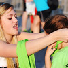 Globe/T. Rob Brown<br /> Olivia Massey, left, of Joplin, a Runaround employee, puts a completion medal on Molly Stevens, 4, of Joplin, for finishing the Memorial Run Saturday morning, May 18, 2013, in downtown Joplin.