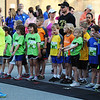 Globe/T. Rob Brown<br /> Joanna Rhodes of Pittsburg, Kan., left, a volunteer, leads the children in stretches before the start of the Kids Memorial Run Saturday morning, May 18, 2013, in downtown Joplin.