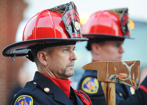 Globe/T. Rob Brown<br /> Joplin Fire Department Capt. Eric Walters, Honor Guard coordinator, leads the guard in ceremony prior to the start of the Memorial Run Saturday morning, May 18, 2013, in downtown Joplin.
