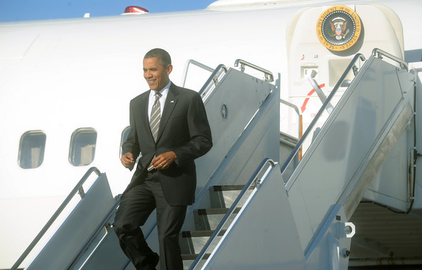 Globe/Roger Nomer<br /> President Barack Obama jogs off Airforce One as it arrives in Joplin for Joplin High graduation on Monday.