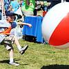 Globe/T. Rob Brown<br /> Sam Moore, 7, of Joplin, kicks a beach ball as big as he is on Tuesday afternoon, May 22, 2012, during an activity time for children at the old Irving Elementary School location.