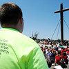 Globe/T. Rob Brown<br /> Logan Allgood, of Joplin, a member of St. Mary's Catholic Church, wears a faith shirt as he listens during a prayer service held under the church's large, metal cross Tuesday afternoon, May 22, 2012.
