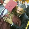 Globe/Roger Nomer<br /> President Barack Obama embraces a graduate before Joplin High graduation on Monday.