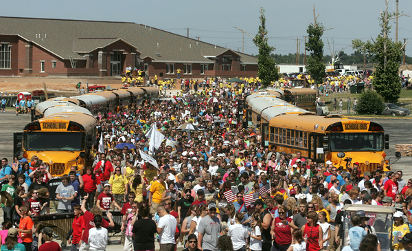 Globe/Roger Nomer<br /> The Walk of Unity enters the grounds of Joplin High School during Tuesday's event.