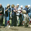Globe/Roger Nomer<br /> Joplin High staff and students break ground for the new building during the Walk of Unity on Tuesday.
