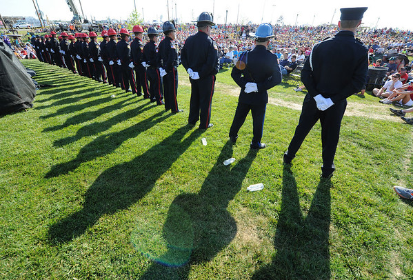 Globe/T. Rob Brown<br /> Joplin firefighters stand at attention Tuesday evening, May 22, 2012. Their shadows cast as the time approaches 5:41.