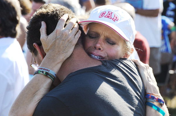 Globe/T. Rob Brown<br /> Marilyn Sixx, of Joplin, embraces her son, Chris Sixx, during the ceremony at Cunningham Park, the finale for the Unity Walk Tuesday evening, May 22, 2012.