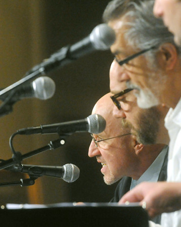 Globe/Roger Nomer<br /> (from left) Actors Arliss Howard, Paul Giamatti and David Strathairn read a passage from the Book of Job on Sunday at College Heights.