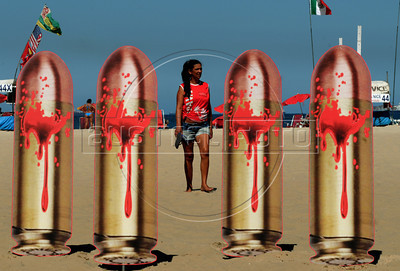 "A woman past by twenty one images of bullets were set up in Copacabana beach by non governmental organization Rio of Peace (Rio de Paz) on the anniversary of the murder of Brazilian judge Patricia Acioli -shot dead as she returned home-, Rio de Janeiro, Brazil, August 10, 2012.In the banner says: ""Twenty bullets into Justice"".  Brazilian judge Patrícia Acioli was killed on August 11, 2011 by two gunmen apparently under orders of policemen involved in private security militia. (Austral Foto/Renzo Gostoli)"