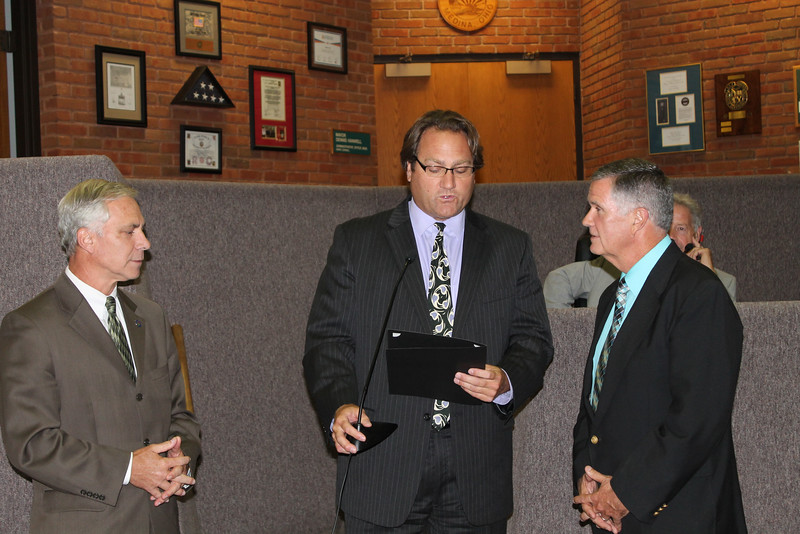 LAWRENCE PANTAGES / GAZETTE From left, Medina Mayor Dennis Hanwell and City Council President John Coyne present a resolution thanking Medina City Schools Superintendent Dave Knight for his service as he retires at the end of the month.