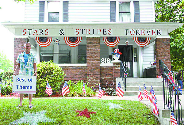 """Brock Isenhower, of 818 North Meridian Street, won the best of theme award for his decorated porch, portraying this year's theme """"Stars and Stripes Forever."""""""