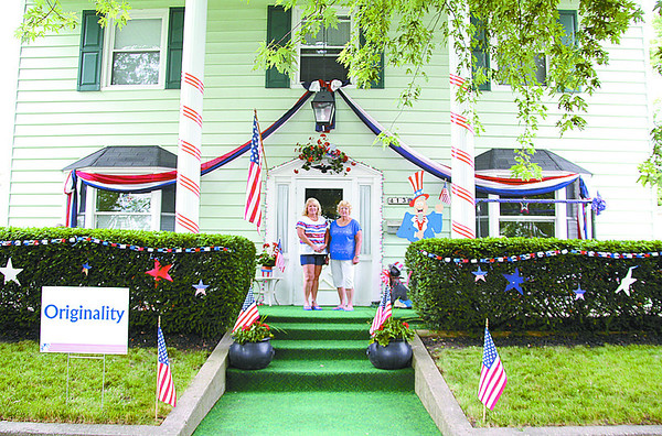 Maxine Uhler, right, shown here with her daughter, Lana Hale, won the originality award for her decorated porch at 413 North East Street.