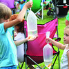 Gwyneth Gray, 6, and Leah Ziats, 3, admire the goldfish they received at the Boone County Fourth of July Celebration carnival Friday evening.