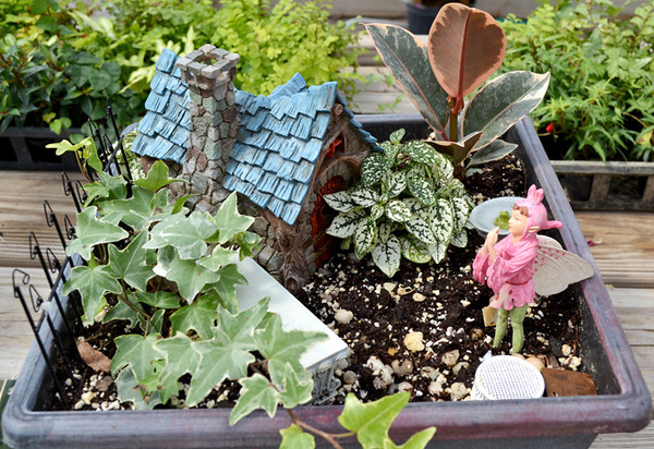 The presence of a fairy in this miniature garden makes it, logically, a fairy garden.