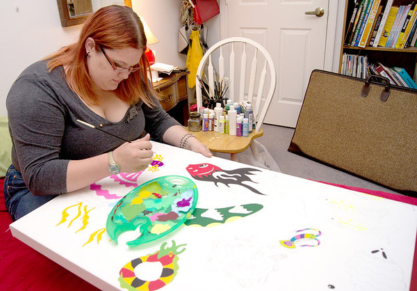 Zionsville native and current Lebanon resident, 22-year-old Kristen Wise, works on one of her paintings. Kristen's artwork was recently featured in Branches, a magazine distributed throughout Indiana.