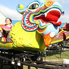 Charlize Frazier, 8, rides a roller coaster at the Poor Jack's Carnival at Lebanon Memorial Park on July 2, 2014.
