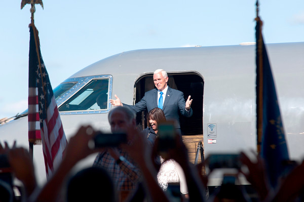 Indiana Gov. Mike Pence is welcomed by a crowd at the Indianapolis Executive Airport Saturday for his first appearance in Indiana after joining Donald Trump's campaign as candidate for Vice President. Pence and family briefly addressed supporters about issues important to him and his family.
