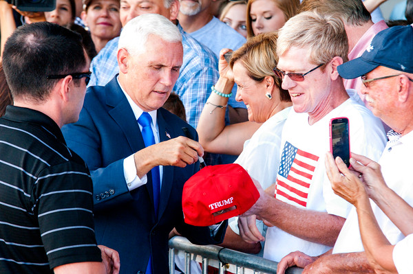 Indiana Gov. Mike Pence signed autographs and took photos with supporters at the Indianapolis Executive Airport Saturday after a brief speech. It was announced Friday that Pence would be the running mate of Donald Trump.