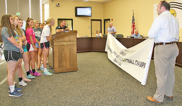 "BANNER YEAR<br /> Elizabeth Pearl | The Lebanon Reporter<br /> LET'S HEAR IT FOR THE GIRLS: The Lebanon Community School Board presented the Lebanon High School girls' softball team with a banner announcing their championship title at the board meeting on Tuesday. The banner reads ""Lebanon; The IHSAA 2016 Class 3A Softball Champions; Tiger Pride."" Though the placement of the banner is not yet set, it will likely hang either inside or outside the gym during the off season and along the outfield fence during the season, said Robert Taylor, Lebanon Community School Corp. superintendent. <br /> ""We can get a second banner next year,"" Taylor told the girls who would be back next season."